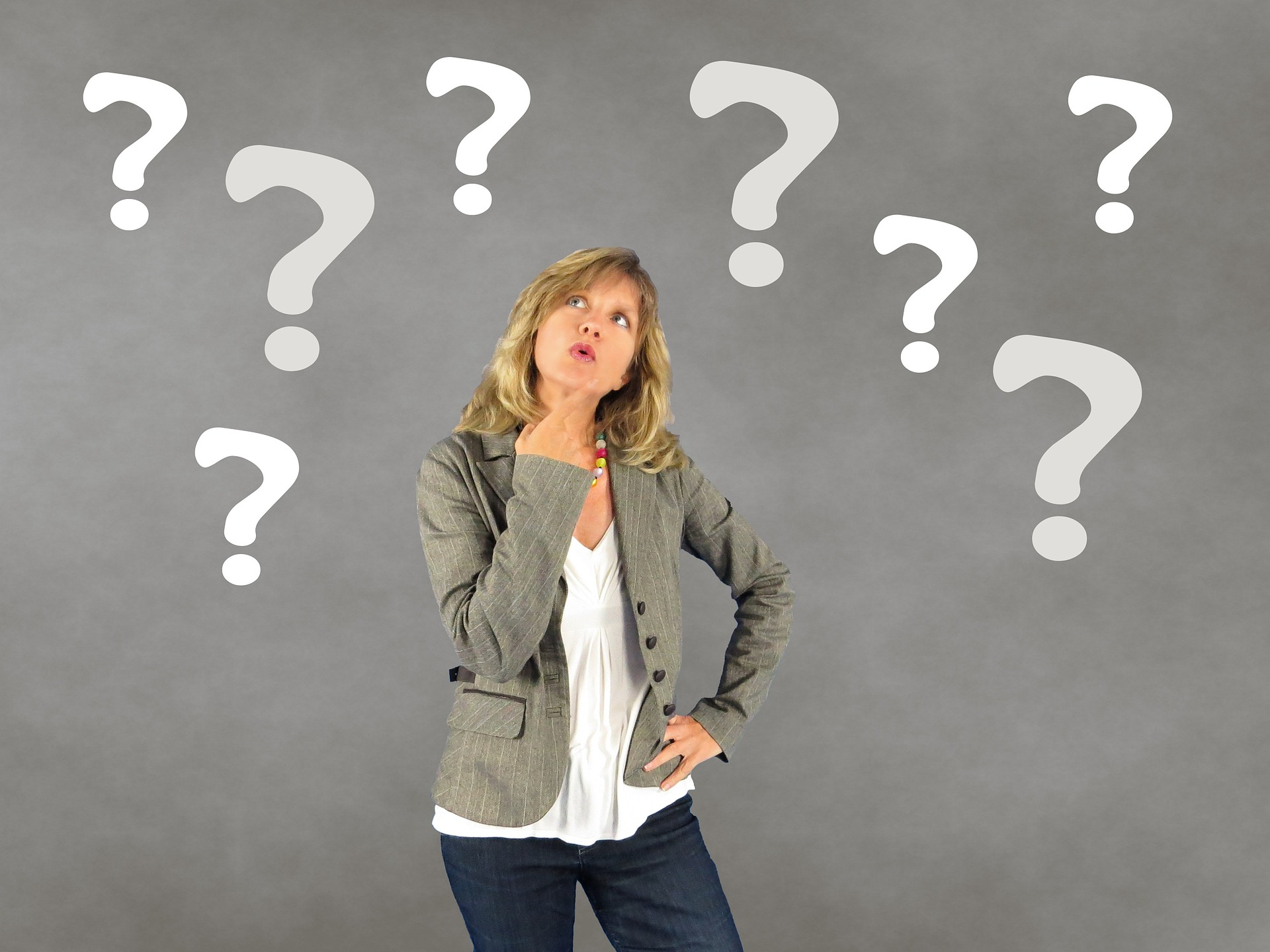 Woman looking upwards wondering about the answer to a question