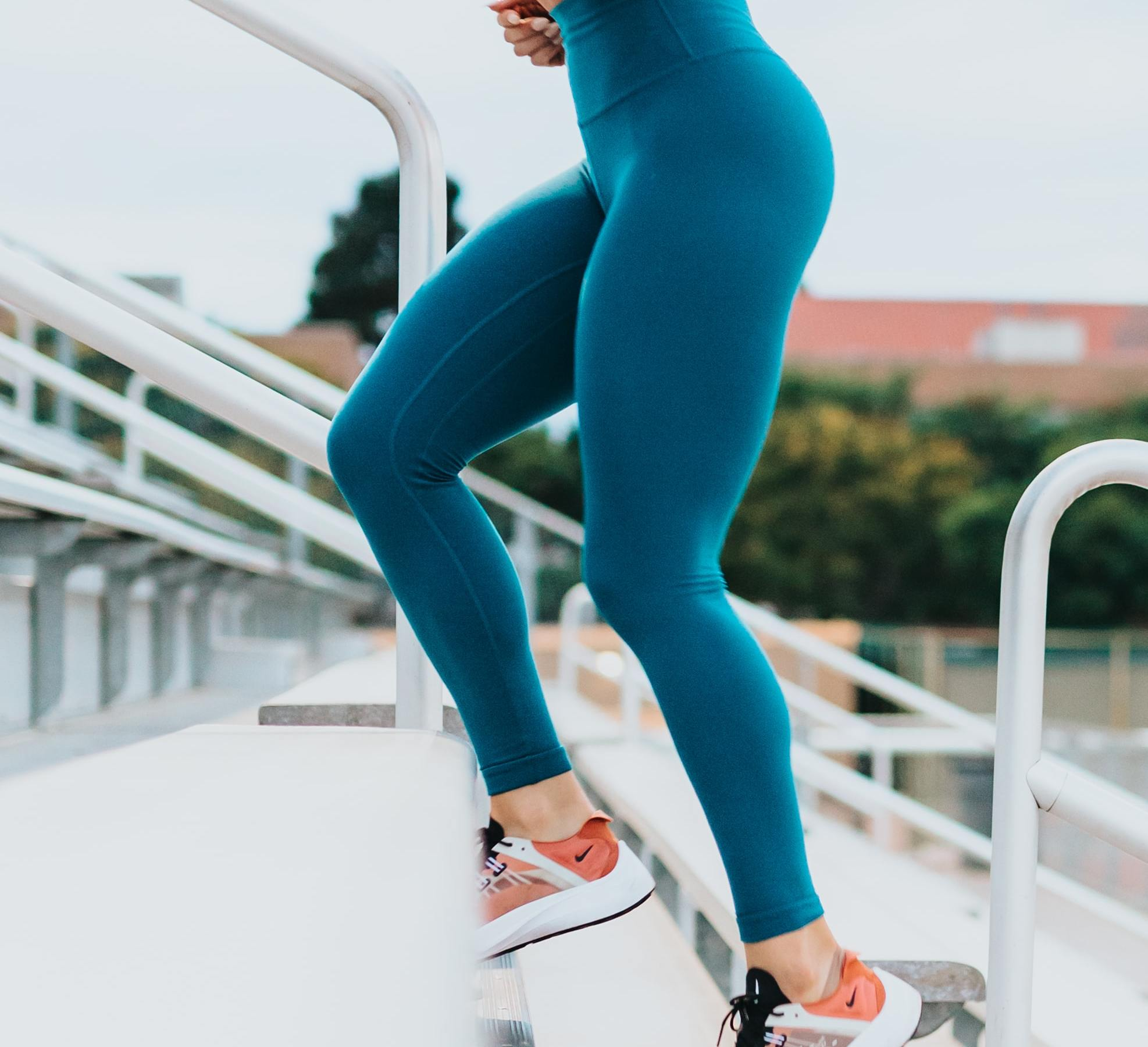 woman running up stadium steps